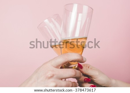 Close up of Two woman hands making good cheer - stock photo