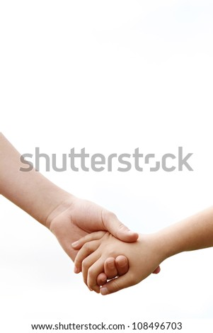 Close up of two young girls holding hands against the sky. - stock photo