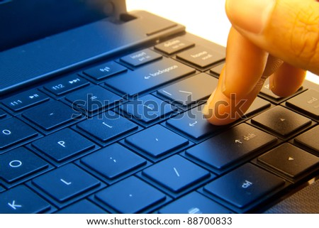 Close-up of typing male hands. - stock photo