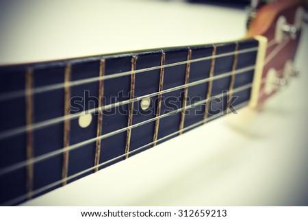 Close up of ukulele  with soft light (Vintage color tone) - stock photo
