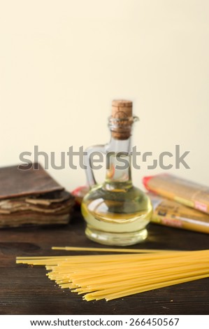 close up of uncooked spaghetti on wood, italin ingredient - stock photo