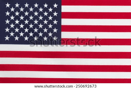 Close up of United States of America flag in horizontal layout. Cloth Texture.  - stock photo