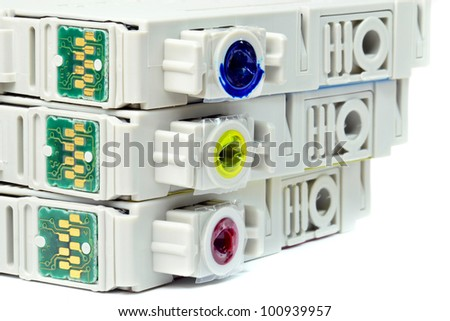 Close up of used coloured ink printer cartridges with chips - stock photo