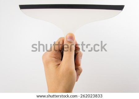 close up of using a squeegee to clearing with white background - stock photo