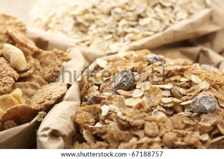 Close-up of various breakfast cereals in paper bags. - stock photo