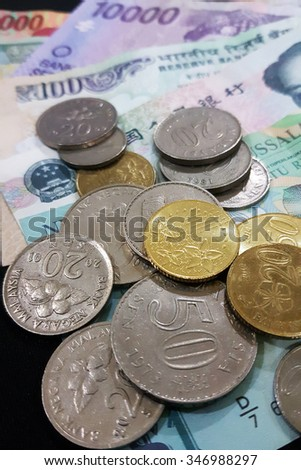 Close up of various country currency note and coins. Soft focus and selective focus image  - stock photo