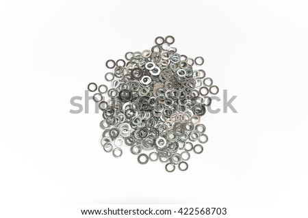 Close-up of various steel nuts and bolts - stock photo