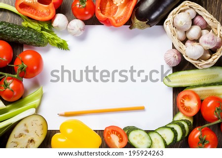 Close up of various vegetables and paper sheet - stock photo