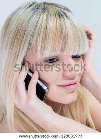 Close-up of Very attractive teen girl with mobile phone - stock photo