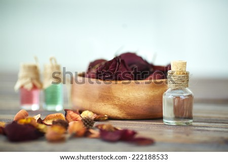 Close-up of vials with rose essence - stock photo