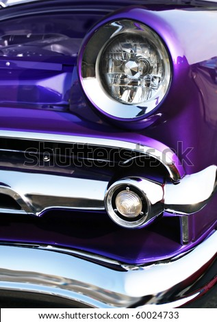 Close up of vintage car with a modern paint job - stock photo