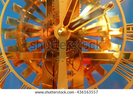 close up of vintage clock. select focus at gears - stock photo