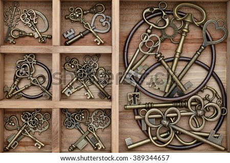 close up of vintage key in old wooden box  - stock photo