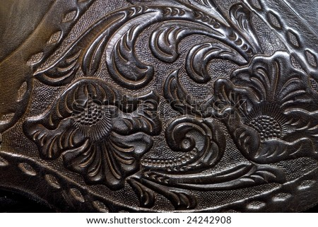 Close up of Vintage leather horse saddle, with flower and swirl design, for background texture - stock photo