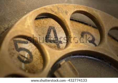 Close up of Vintage phone dial, dirty and scratched - 4, perspective - stock photo