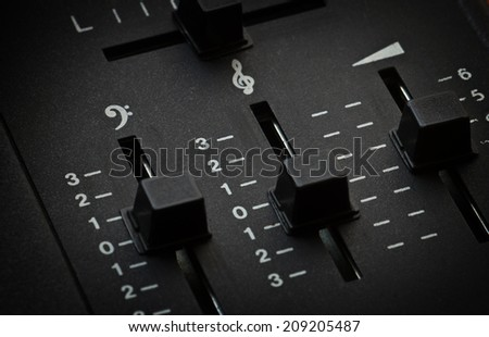 Close up of vintage record player - volume and EQ sliders - stock photo