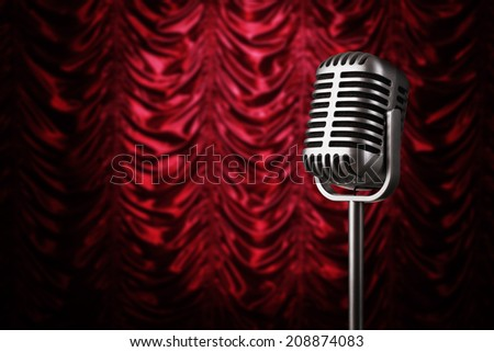 Close up of vintage silver microphone at the theater stage with copy space - stock photo