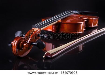Close-up Of Vintage Violin Over Black Background - stock photo