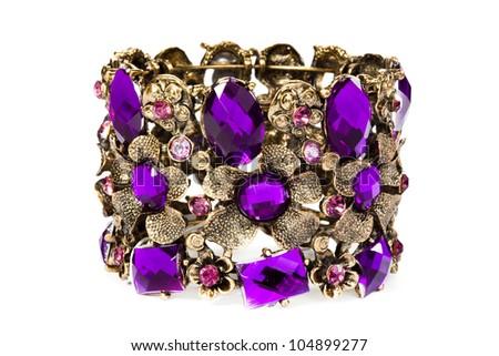 Close-up of violet bracelet isolated on white background - stock photo