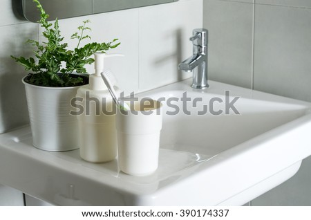 Close up of washbasin in a modern bathroom - stock photo