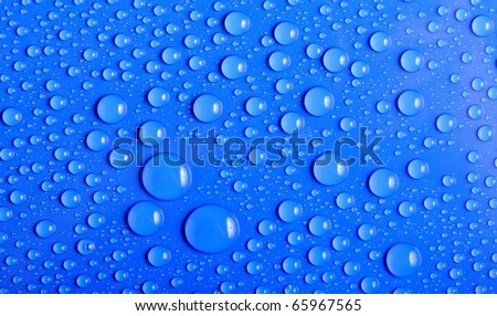 Close up of water drops in blue with shallow depth of field - stock photo