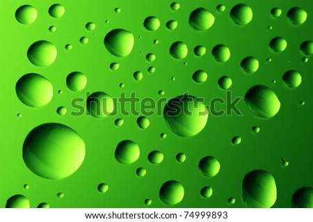 Close-up of water drops on glass surface as background. - stock photo