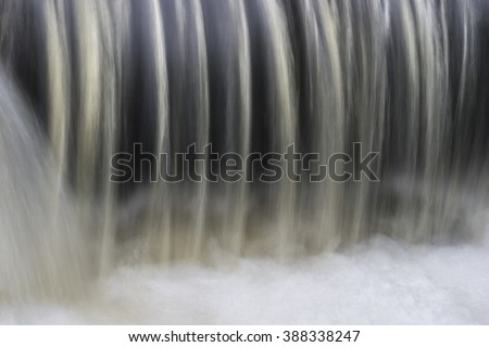 Close up of water in waterfall or dam - stock photo