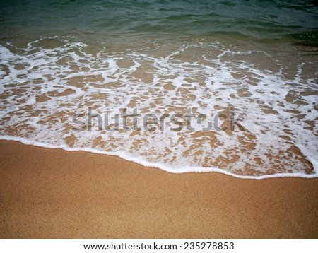close up of wave of the sea on the sand beach  - stock photo