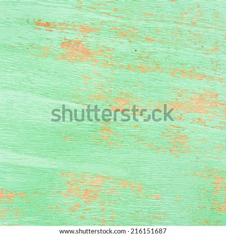 Close up of weathered green painted wood - stock photo
