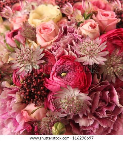 close-up of wedding bouquet with Astrantia, Skimma, Brassica, rose bush, Ranunculus asiaticus, cloves, - stock photo