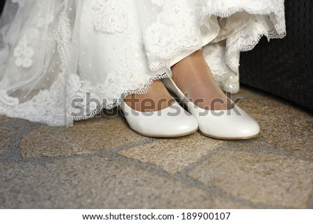 Close-up of white bridal shoes - stock photo