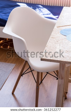 Close up of white comfy desk chair in kid room - stock photo