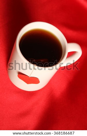 Close-up of white cup of tea and a label in the form of heart - stock photo