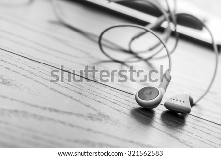 Close up of white earphones - stock photo