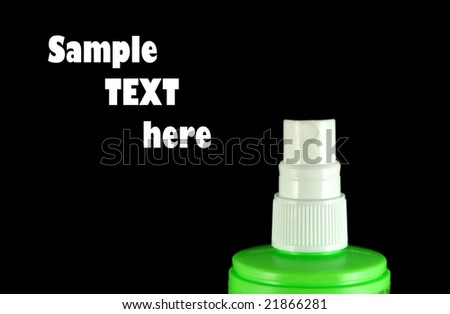 Close-up of white-green aerosol can nozzle isolated on black - stock photo