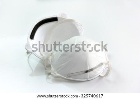 Close up of white mask isolated on white background.  - stock photo