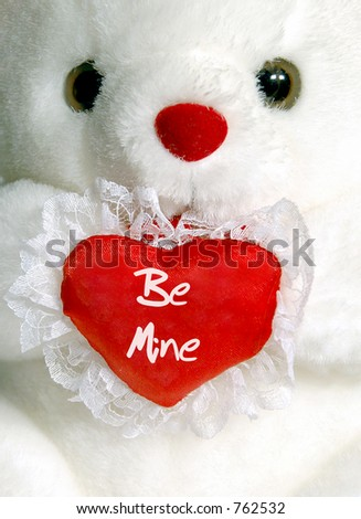 "Close-up of white teddy bear with ""Be Mine"" heart - stock photo"