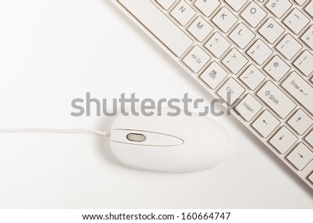 Close up of white wireless keyboard  and wired mouse for concepts of digital information technology media and the internet - stock photo