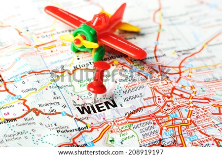 Close up of Wien , Austria  map with red pin and airplane     - Travel concept - stock photo