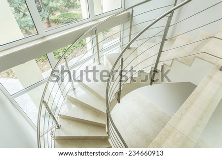 Close-up of winding stairs in luxury apartment - stock photo