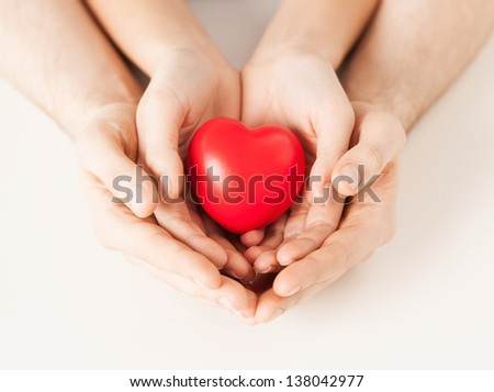 close up of woman and man hands with heart - stock photo