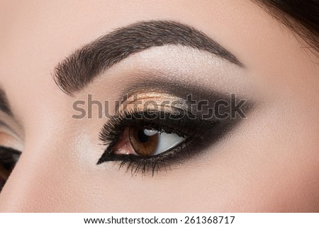 Close-up of woman eye with beautiful arabic makeup - stock photo