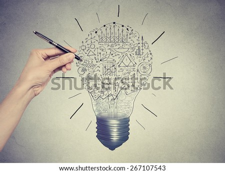 Close up of woman hand drawing business strategy sketches  - stock photo