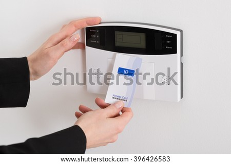 Close-up Of Woman Hand Holding Keycard To Open Door - stock photo