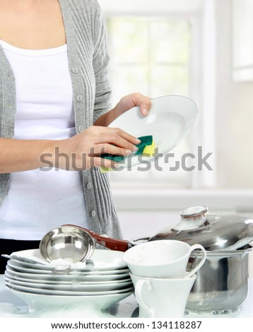close up of Woman hand Washing Dishes in the kitchen - stock photo