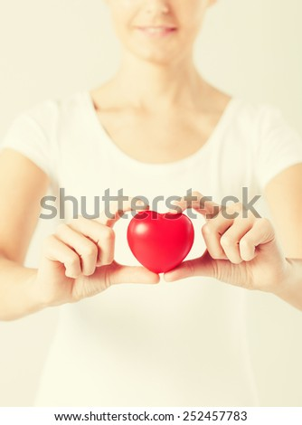 close up of woman hands with heart - stock photo