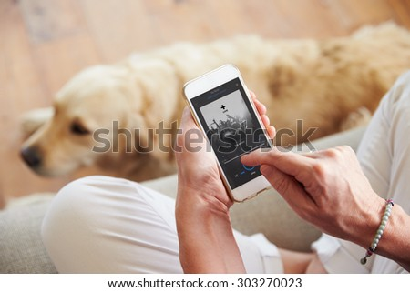 Close Up Of Woman Listening To Music Smartphone At Home - stock photo