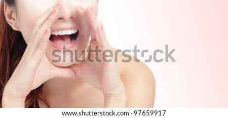 close up of woman mouth deliver message by whispering with pink background, model is a asian beauty - stock photo