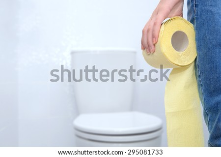 Close-up of woman on toilet . - stock photo