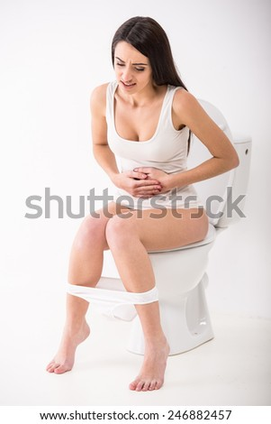 Close-up of woman on toilet in morning. - stock photo